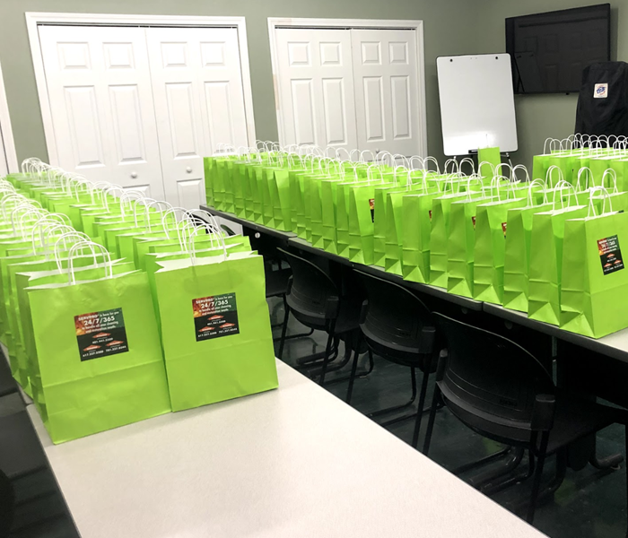 tables with several green gift bags